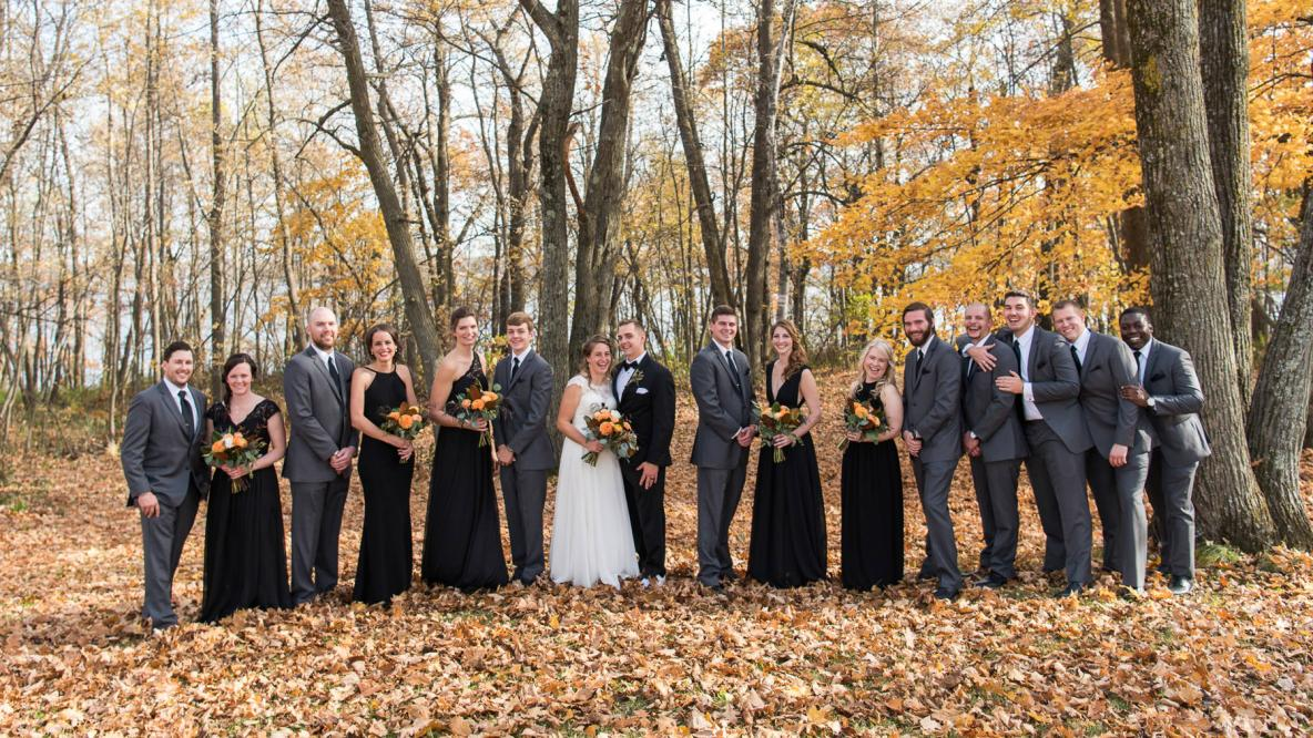 Photos of the wedding party outside in the fall colors.