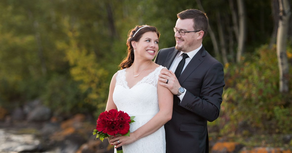 Bride and groom portrait outside in nature.
