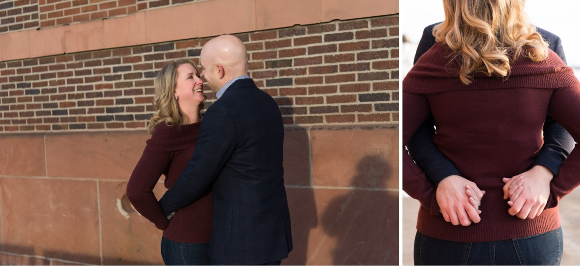 Engagement photo taken outside with brick wall in the background.