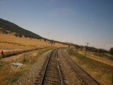 "Crossing train tracks near Harden, Australia, from ""Don't Get Delayed"""