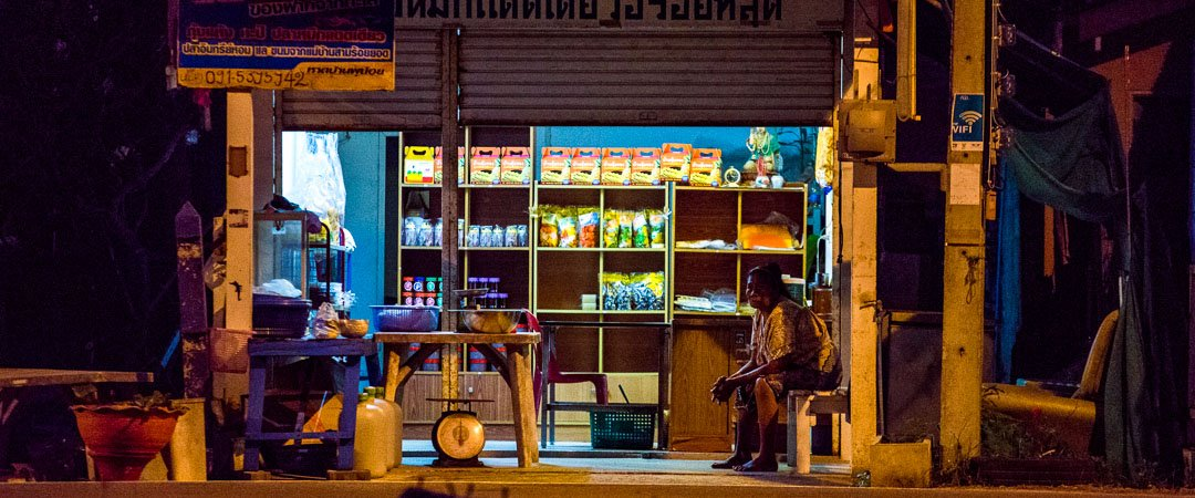 Shopkeeper starting morning early in Sam Roi Yot, Thailand