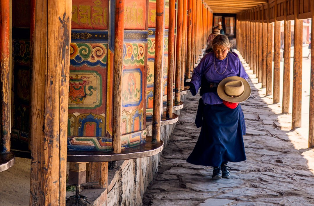 woman with prayer wheels - Labrang Monastery - Labrang China