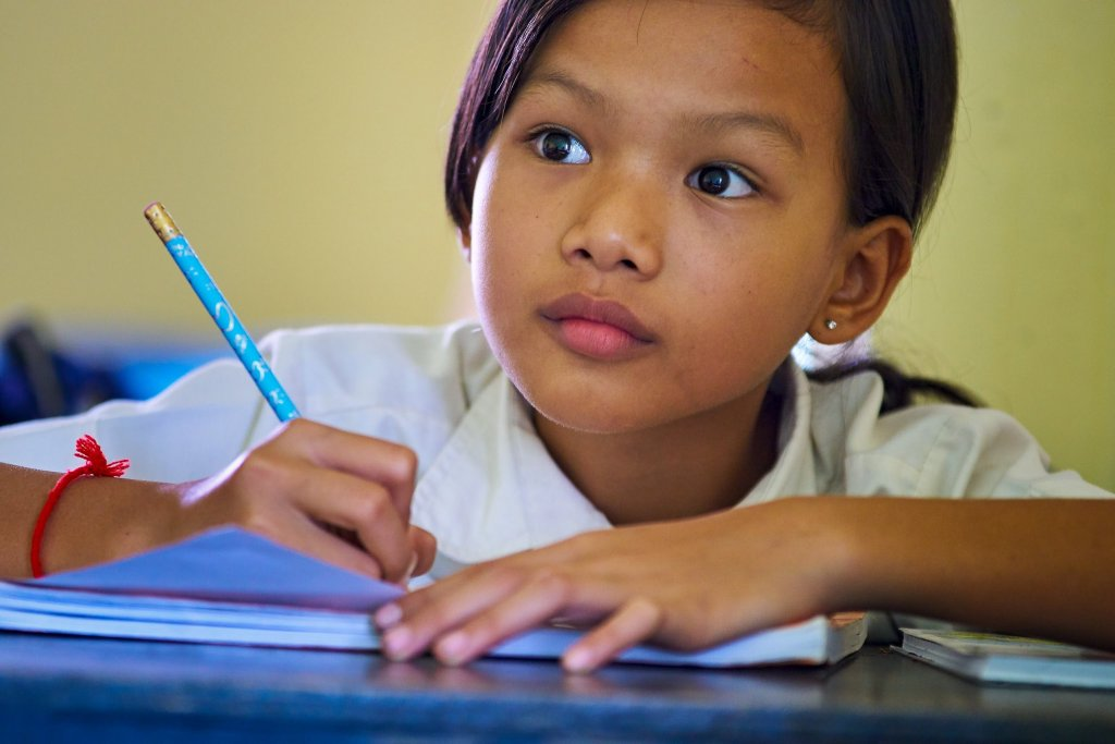 Photo of a Cambodian Girl at School by Humanitarian Photographer Bryon Lippincott