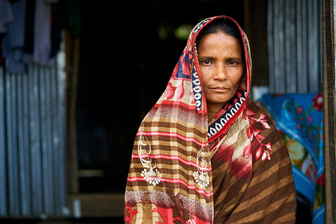 Portrait of a woman on Monpura Island in Bangladesh demonstrating ethical representation by humanitarian photographer, Bryon Lippincott