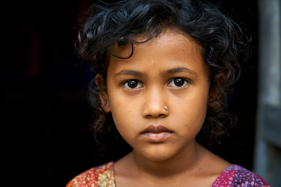 Portrait of a girl from a village in Bangladesh demonstrating ethical representation by humanitarian photographer Bryon Lippincott