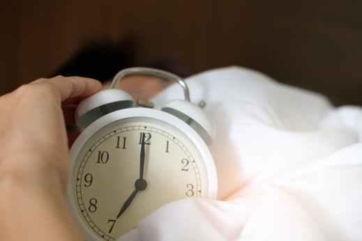 photo of person holding alarm clock