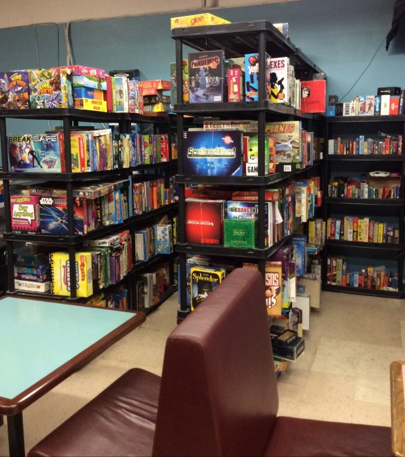 The rack of games at Dicey Business.
