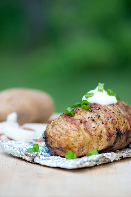 Bacon & Onion Campfire Hasselback Potato | bsinthekitchen.com #camping #dinner #bsinthekitchen
