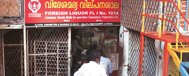A queue outside a retail liquor shop in Kerala