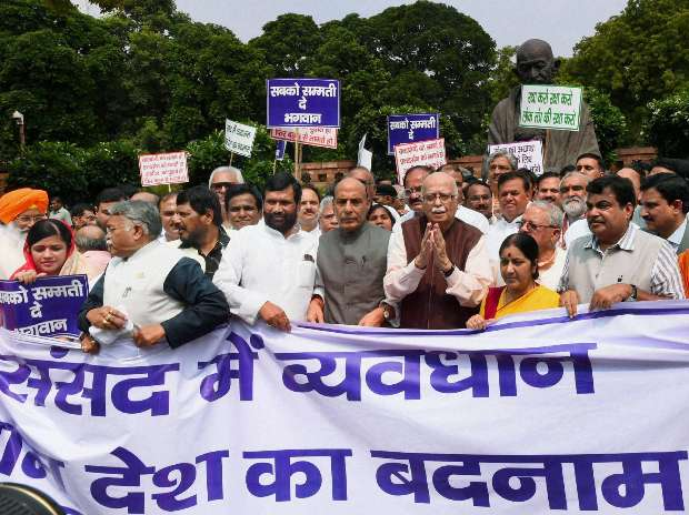 Image result for union minister protesting at gandhi statue