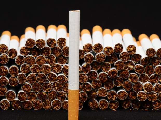 Lower taxes to fire up revenues, earnings for cigarette makers