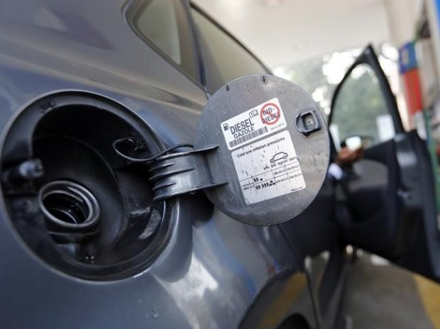 A vehicle waits to be filled up with diesel at a petrol station in New Delhi (photo: Reuters)