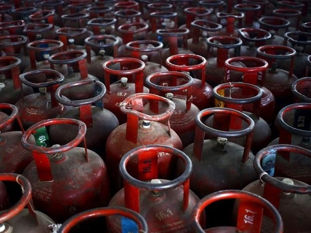 Empty Liquefied Petroleum Gas (LPG) cylinders are seen at a gas distribution centre at Dujana village in Noida (Photo: Reuters)