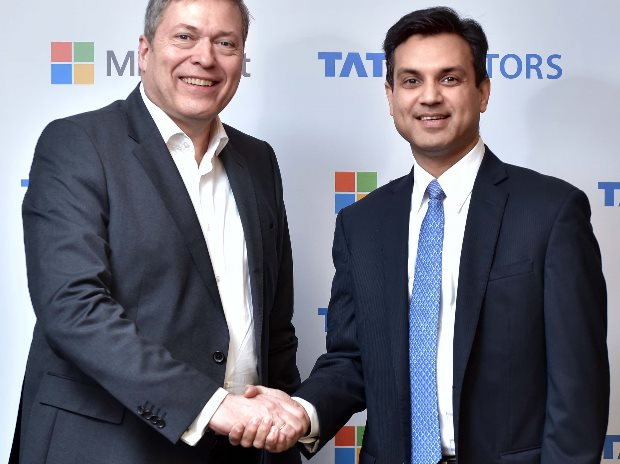 (From left to right) Guenter Butschek, CEO & MD, Tata Motors and  Anant Maheshwari, President, Microsoft India, announcing the collaboration, to redefine the connected experience for automobile users
