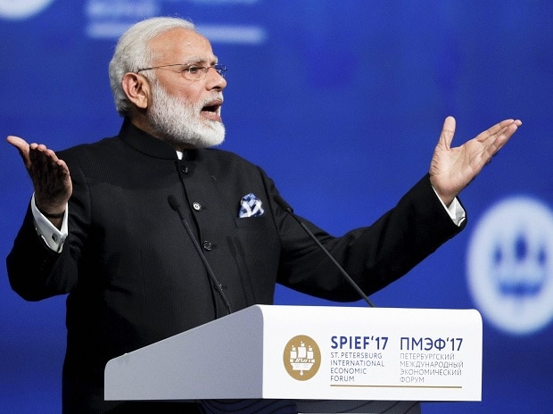 Narendra Modi addresses the St. Petersburg International Economic Forum in St Petersburg, Russia, Friday. Photo: PTI