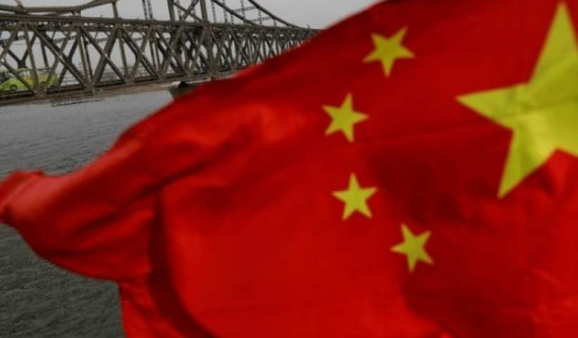China denounces NATO statement, defends country's defense policy