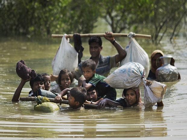 Teknaf : A Rohingya family reaches the Bangladesh border after crossing a creek of the Naf river on the border with Myanmmar, in Cox's Bazar's Teknaf area. Photo: AP/PTI