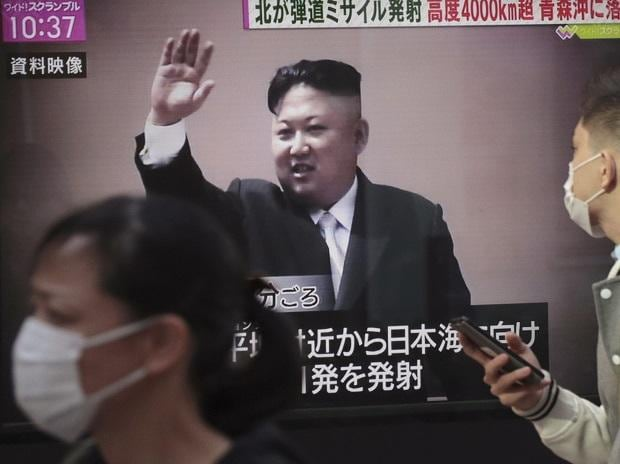 A man looks at a TV screen broadcasting news of North Korea's missile launch, in Tokyo, Wednesday, Nov. 29, 2017. After 2 months of relative peace, North Korea launched its most powerful weapon yet early Wednesday, a presumed intercontinental ballist