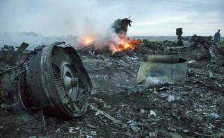 MAGE: 'Burning evidence' – The MH17 crash site near Grabovo in Ukraine's Donetsk region. MH17 was apparently downed on the anniversary of TWA flight 800. While officials have stated that Flight 800 was downed in the Atlantic Ocean because of a feul tank explosion in 1996, many critics have doubted those claims stating that the plane was shot down due to the forensic evidence compiled. (Photo channelnewsasia.com)