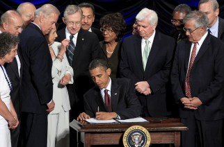 President Obama signs the Dodd-Frank Wall Street Reform and Consumer Protection Act in Washington in 2010. Photograph: Jim Young/Reuters