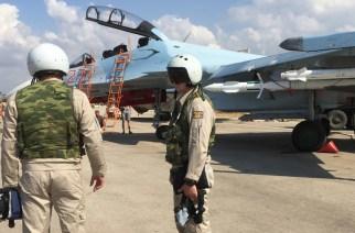 Russian pilots prepared to board the SU-30 attack plane to take off from the Hmeimim aerodrome in Syria. © Dmitriy Vinogradov / RIA Novosti