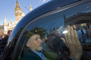Leader of Britain's opposition Labour party, Jeremy Corbyn, passes the Houses of Parliament as he leaves in the back of a taxi in central London on 12 September, 2015 (AFP).