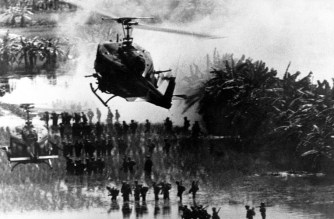 American helicopters protect infantry battalions crossing rice fields 17 August 1967 in an unlocated place during the Vietnam war © / AFP