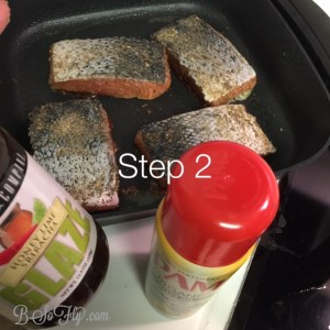 After seasoning the salmon, cook the fish pink side down for about 4 minutes. I set the heat to 350-375 degrees. Pam spray and glaze are optional. Flip the fish after 4 minutes and cook on skin side for an additional 4-5 minutes. I covered the pan at this time.
