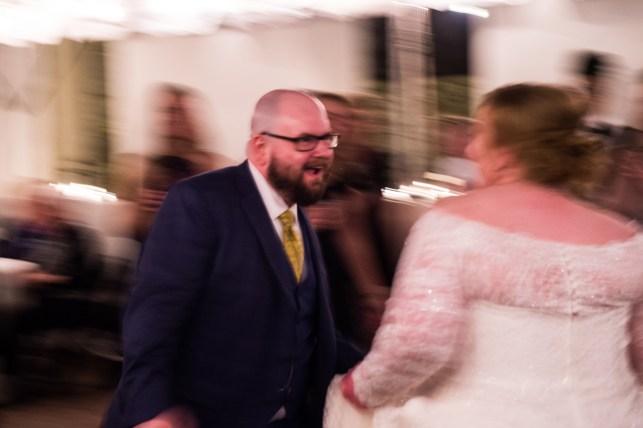 Groom just enjoying dancing and singing to his beautiful bride