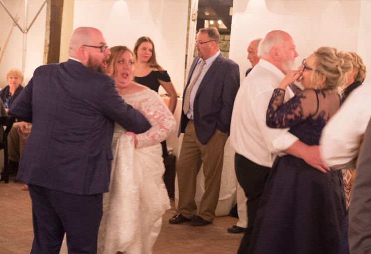 Groom and Bride dancing next to Father and Mother of the Bride.