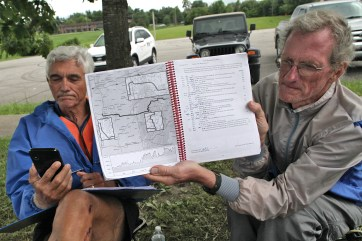 Bloomington time station. Dave Tanner shows the Beacon the RAAM course manual as Terry Bork checks current rider locations on his smartphone. Thursday, June 20, 2019 Race Across America passing through Bloomington, Indiana (Dave Askins/Beacon)