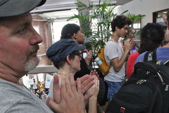 Councilmembers Dave Rollo (foreground) and Isabel Piedmont-Smith (to Rollo's left) were among the climate strikers who filled city hall last Friday, Sept. 20, 2019 (Dave Askins/Beacon)