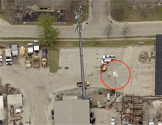 Ariel view of the tornado siren at the City of Bloomington's service area on Miller Drive, east of Henderson Street. Red circle is magnified view of siren. (Monroe County GIS Pictometry tool)
