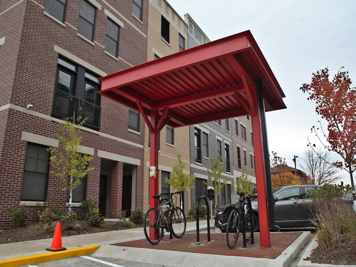 This is the city's first covered bicycle rack, on the west side of North Morton Street in downtown, installed as a part of the recently completed Omega Properties project. A resident has started parking his motorcycle there, according to city parking enforcement staff, which there is no ordinance against, they say. (Dave Askins/Beacon)
