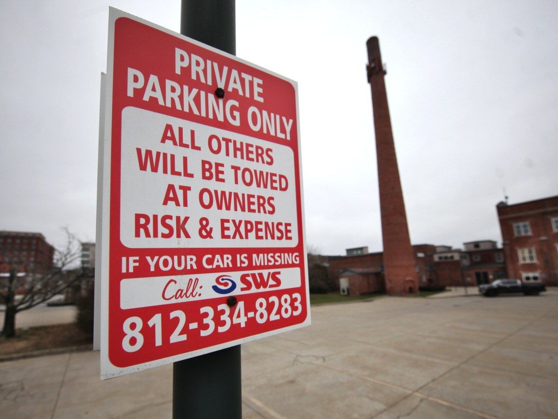 The proposed new ordinance on non-consensual towing would require signs similar to these, which are already in place.