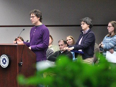 At the podium is Eric Schedler, of Muddy Fork Farm & Bakery, who advocated for a reduction in fees for food and beverage artisans at Bloomington's farmers market.