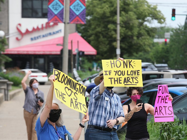 """Arts supporters on May 22. Holding the """"Honk if you love the arts"""" sign is Ken Buzzard."""