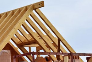 7 reasons you need a new roof picture of a roof truss being built for a new roof