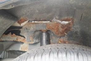 Typical rusted shock mounts (passenger side shown)