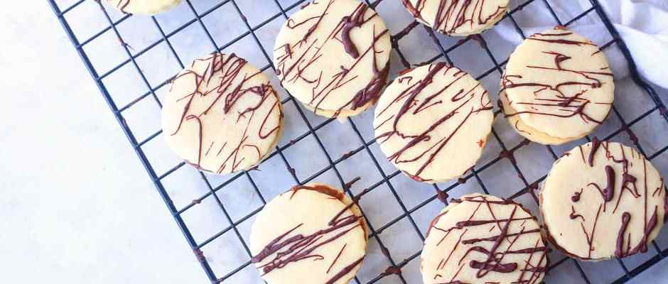 Shortbread Nutella Sandwich Cookies recipe on a cooling rack