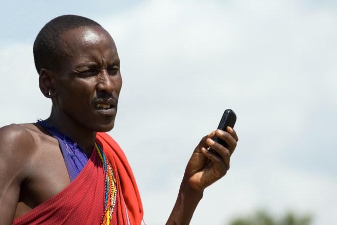 Kenya: Masai man with mobile