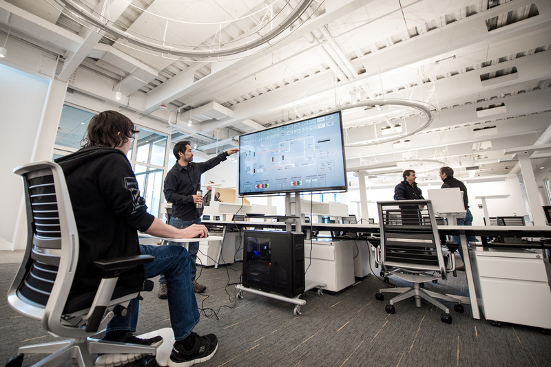 Virtual Technology And Design Students Demonstrate A Nuclear Controls Simulator At The IRIC. Photo by University of Idaho Photo Service.