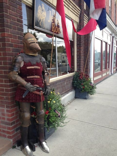 A suit of armor outside a shop window greets passers by. Photo by Kate Abbott