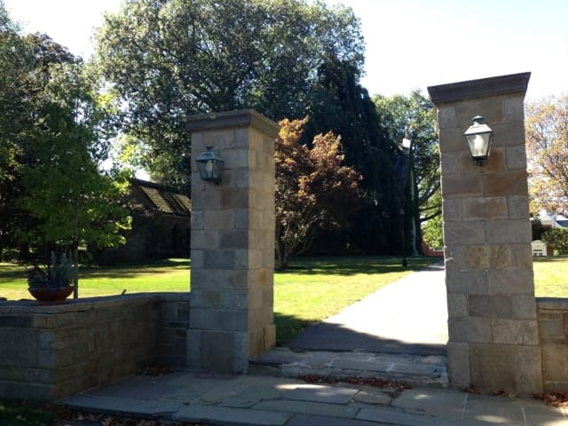 The gates to the estate that now houses now the Pomfret School show the scale of houses on Pomfret Street. Photo by Kate Abbott