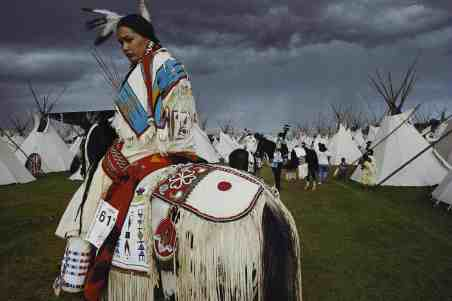 At the Pendleton Round-Up in Oregon, Acosia Red Elk, American Indian Beauty Pageant winner, waits for a parade in 1997. Photo by William Albert Allard/ National Geographic . Part of 'Greatest Photographs of the American West'.