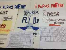 Flyers show a range of type and images at Press Gallery, now ExPress. Photo by Kate Abbott