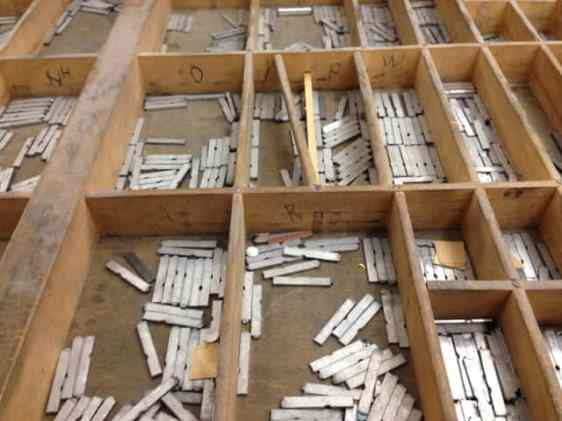 Metal type fills a drawer, arranged by letter. Photo by Kate Abbott