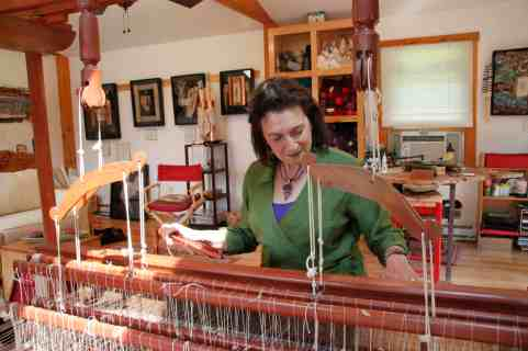 Wendy Rabinowitz works at her loom. Photo courtesy of Susan Geller.