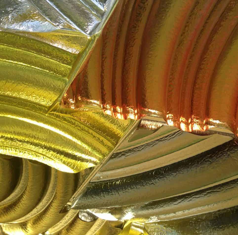 """Arcs of colored glass gleam in Berkshire glass artist William Carlson's """"Vetro Muralis."""" Photo by Kate Abbott"""