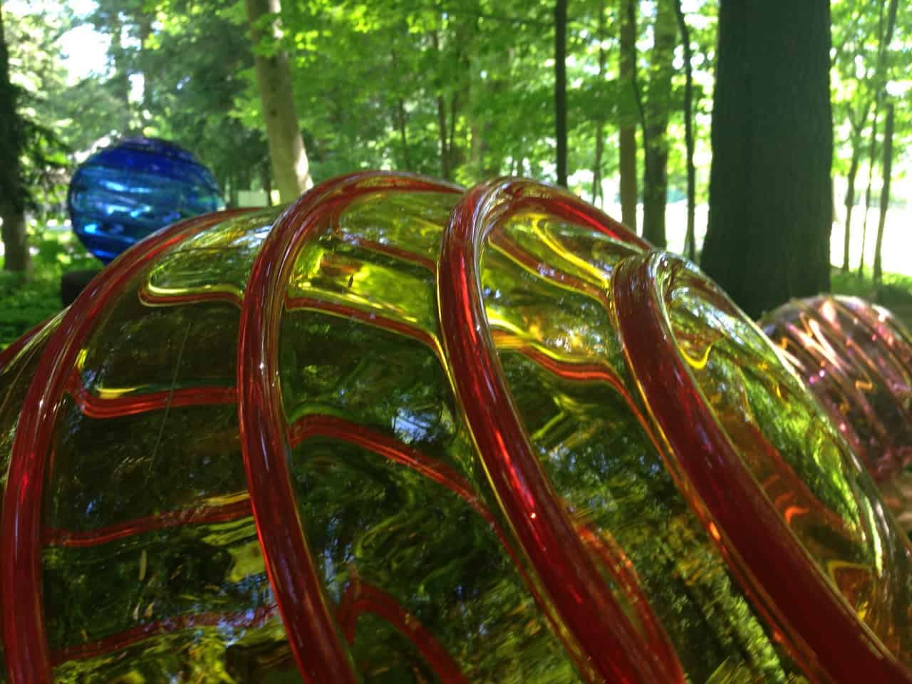 "A blown glass globe in Richard Royal's ""Optic Lens"" reflects the trees at Chesterwood. Photo by Kate Abbott"